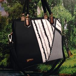 Cynthia Williams verified customer review of Black and White Striped Leather Handbag