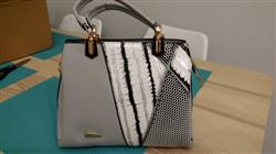 Bonita Hayworth verified customer review of Black and White Striped Leather Handbag