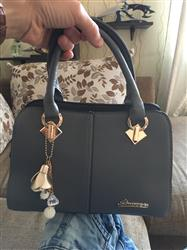 Louise King verified customer review of Solid Tote Handbag With Ornament Keychain