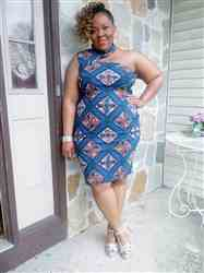 Ayesha P. verified customer review of Amaka African Print Asymmetric Bodycon Dress (Blue Tan Diamonds)