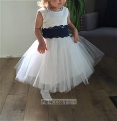 Katie Buckley verified customer review of Ivory Satin Tulle Flower Girl Dress with navy blue Lace sash