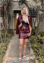 Bruna Sousa verified customer review of Faux Leather Or Worse Wrap Mini Skirt in Burgundy