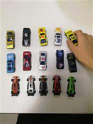 Owen. Smith verified customer review of PROLOSO 50 Toy Cars Playset with Road Tapes Bend Stickers DIY Vehicle Tracks Early Learning