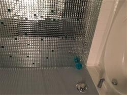 Lee H. verified customer review of 10 Pack | 12x12 Silver Peel and Stick Mirror Wall Tiles