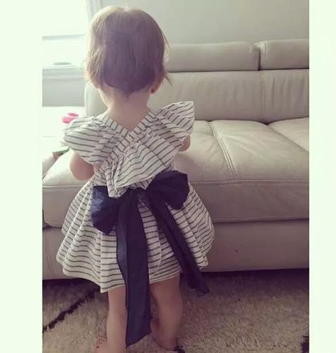 White and gray striped ruffle swing set