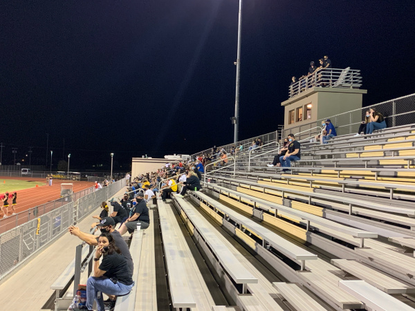 Fans sit in a socially distanced set of stands