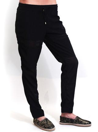 Pantalón negro Bold recortes con transparencias, Promesse