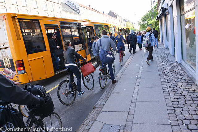 Danish cyclists between bus and pedestrians