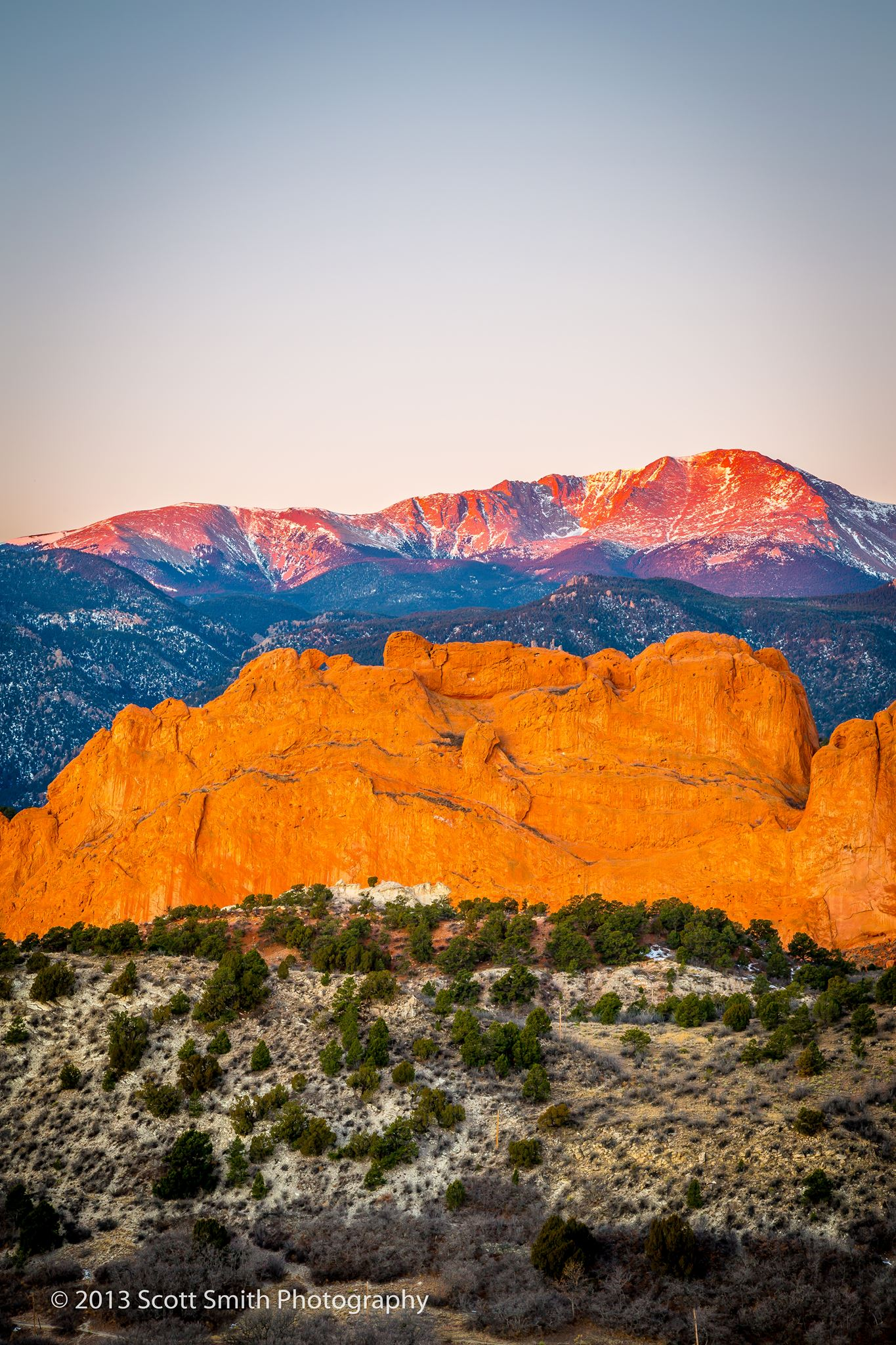 Morning Peaks - Pike's Peak, behind the Garden of the Gods, lit by the rising sun. by D Scott Smith