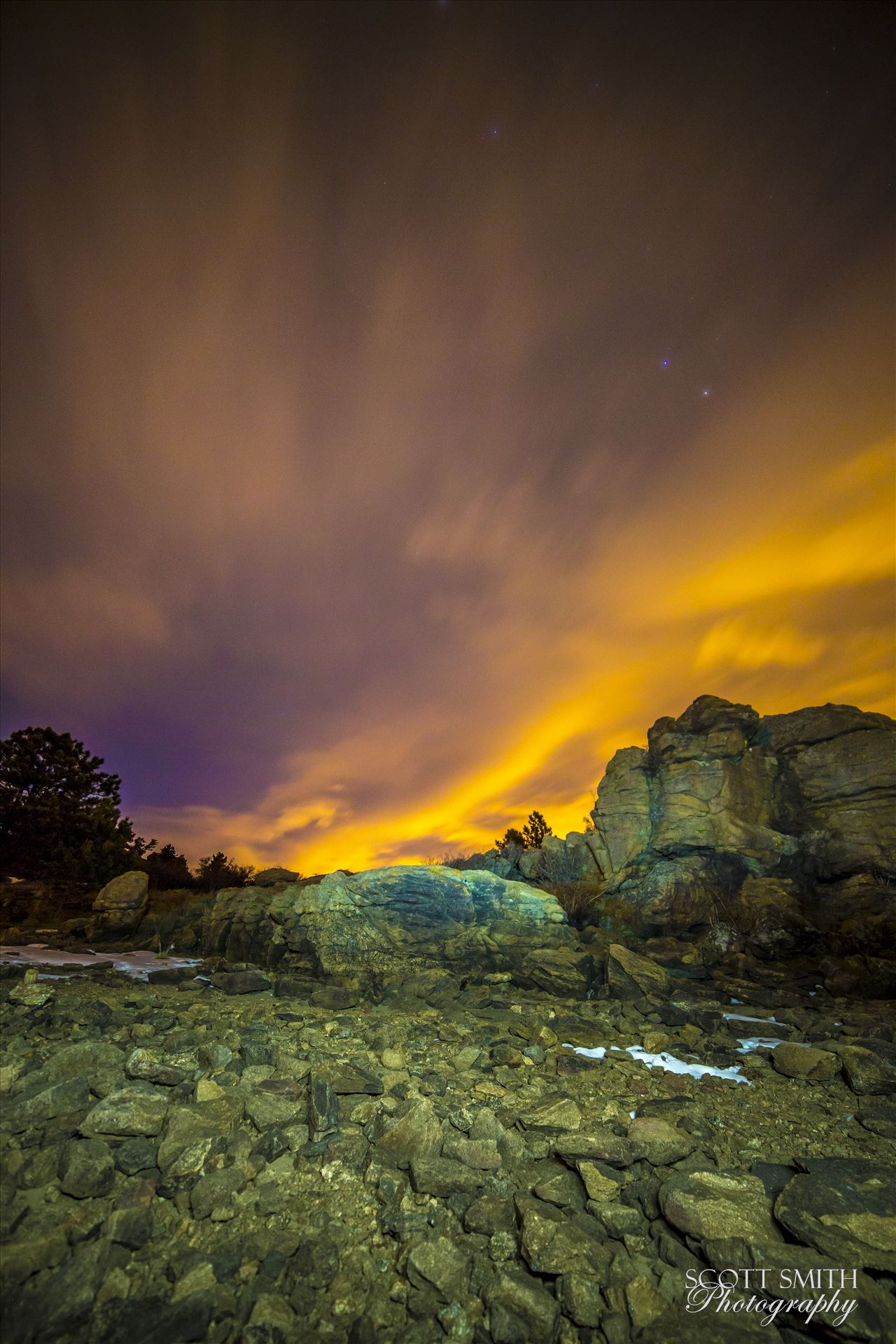 Night Sky on Fire at Mary's Lake - Clouds lit from distant Boulder and Denver light the sky at midnight.  From the shore of Mary's Lake a few miles near Estes Park, looking east towards Denver. by D Scott Smith