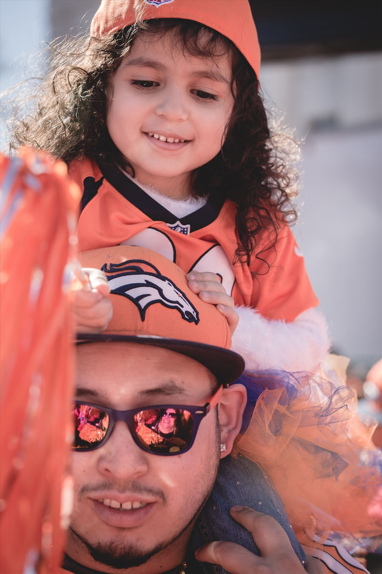 Father Daughter Broncos Fans - If you know who these two are... please contact me! I'd love to pass their photo long to them. by D Scott Smith