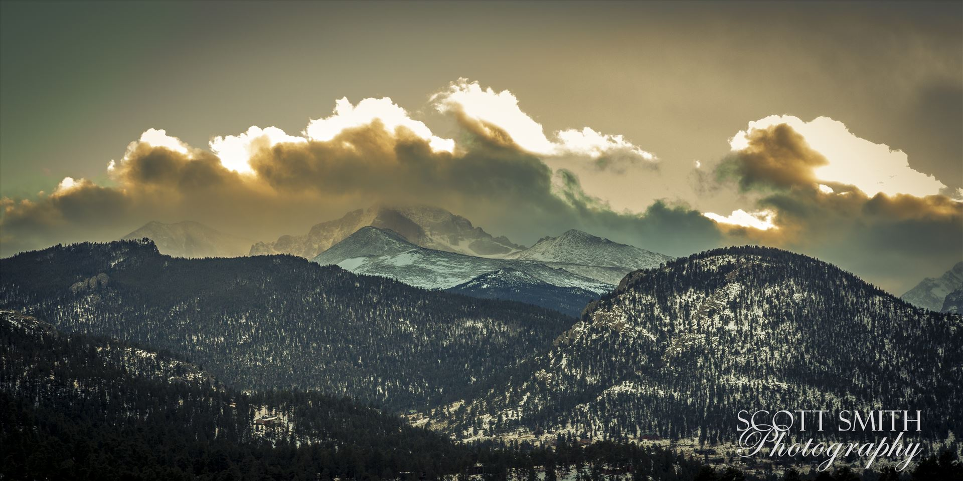 Sunset from Estes - The sun sets over peaks in the Rocky Mountain National Park, as seen from near the famous Stanley Hotel in Estes Park. by D Scott Smith