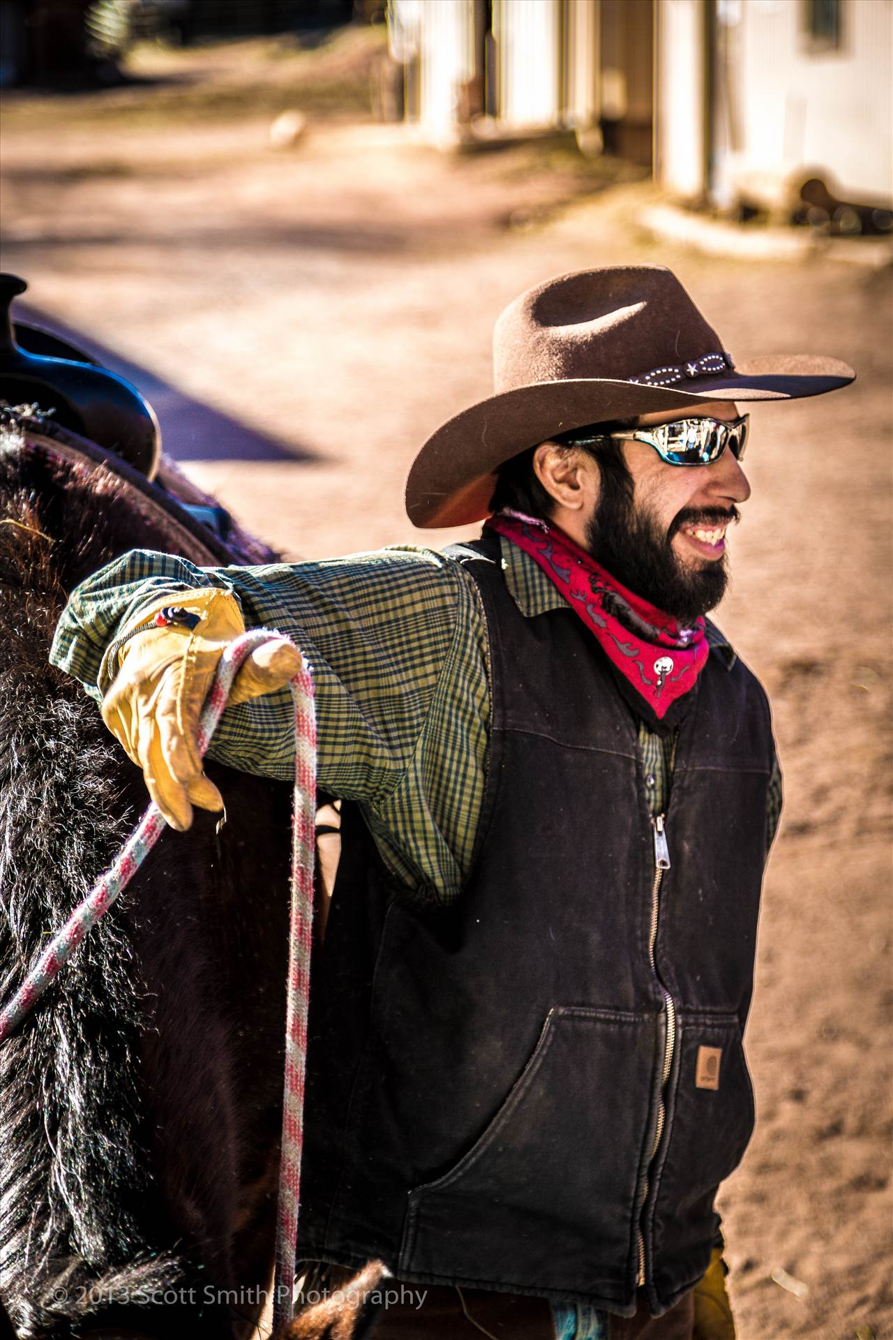 Garden of the Gods Ranch Hand - Helping load the family up on the horses for a ride through the Garden of the Gods. by D Scott Smith