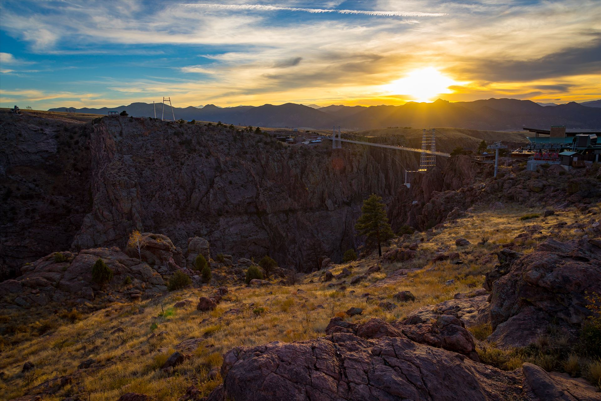 Royal Gorge No 3 - The sun sets over the bridge at the Royal Gorge, near Canon City, Colorado. The bridge is the highest bridge in North America, at almost 1,000 feet over the Arkansas River. by D Scott Smith