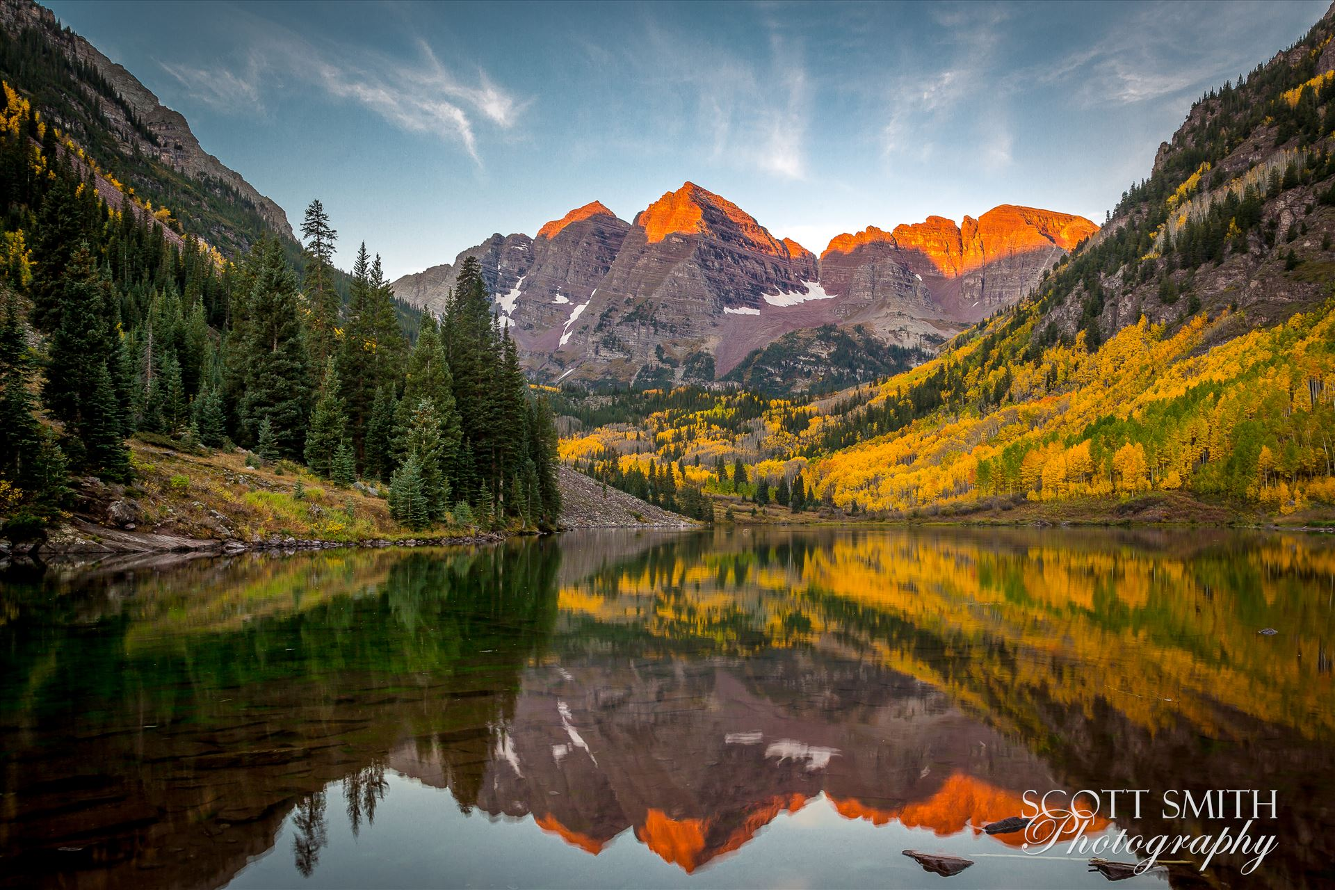 The sun rising on the Maroon Bells - A chilly September morning.  The sun lights the peaks of the Maroon Bells. by D Scott Smith