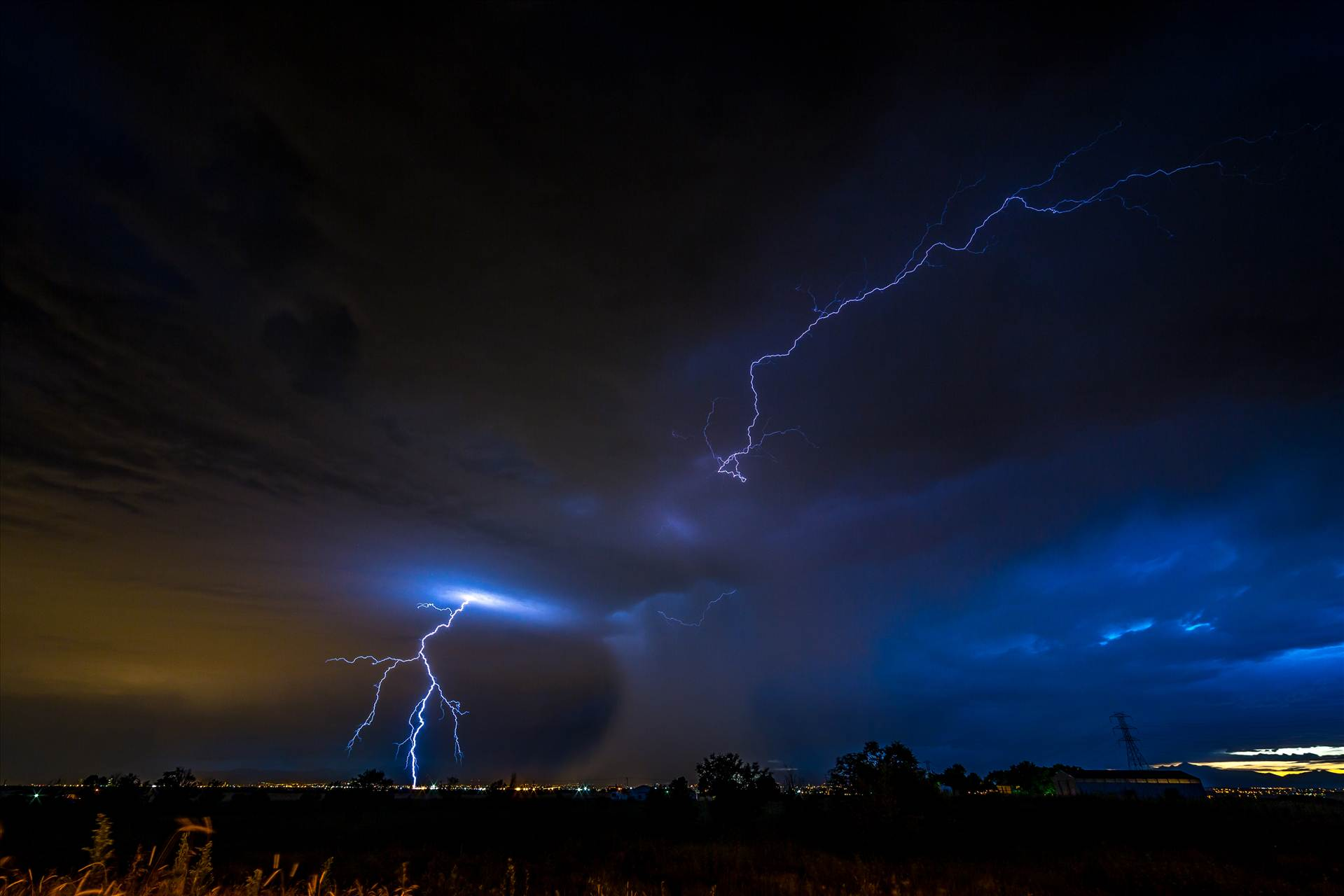 Lightning Flashes 5 - A series of shots from the end of the street, during a powerful lightning storm near Reunion, Colorado. by D Scott Smith