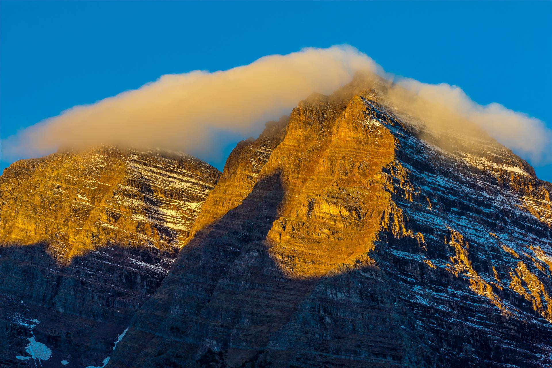 Maroon and Pyramiid Peaks Detail - Two stoic peaks rise above the Maroon Lake, waiting for the morning sun to reach out, as a low cloud slides over. by D Scott Smith