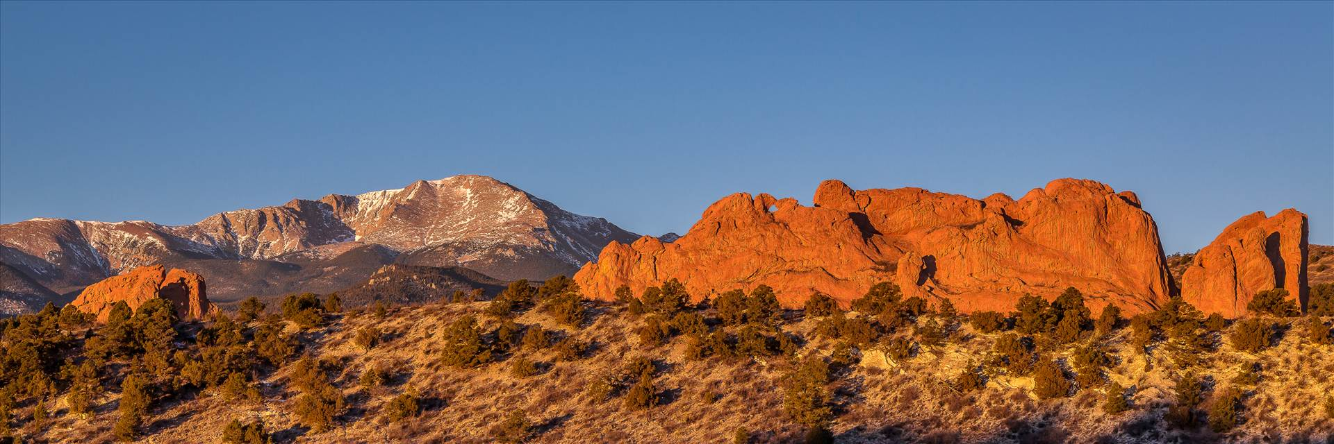 Garden of the Gods Sunrise - The Garden of  the Gods with Pike's Peak in the distance. by D Scott Smith