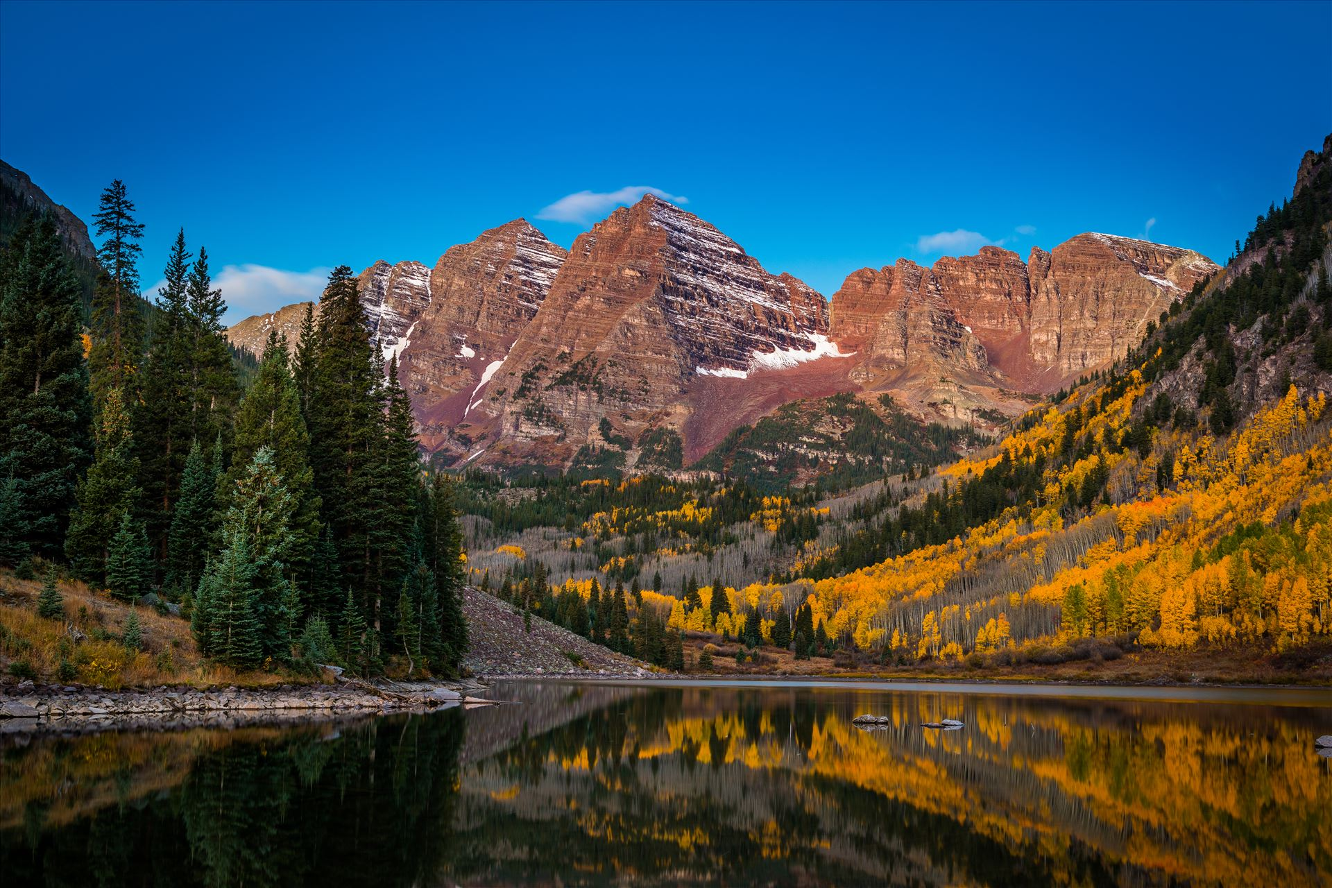 Maroon Bells Before Sunrise Wide - Pre-dawn light casts the maroon hue over Maroon and Pyramid Peaks. The long fifteen second exposure did cost some details in the reflections but was needed at this level of light. by D Scott Smith