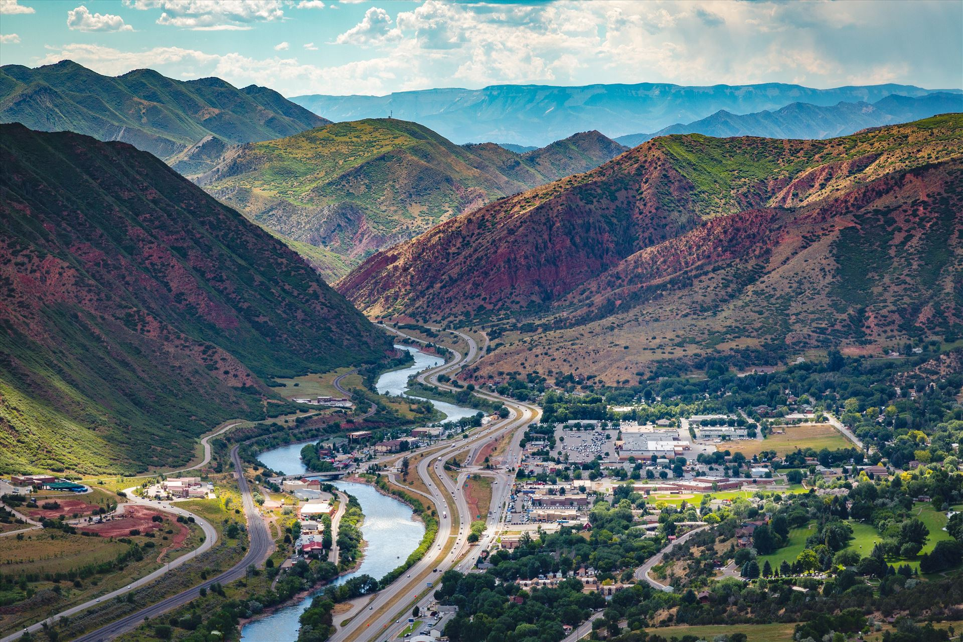 Glenwood Springs from Glenwood Caverns No 2 - Landscape version of the view from the top of Glenwood Caverns, the city of Glenwood Springs, Colorado looks miniature. by D Scott Smith