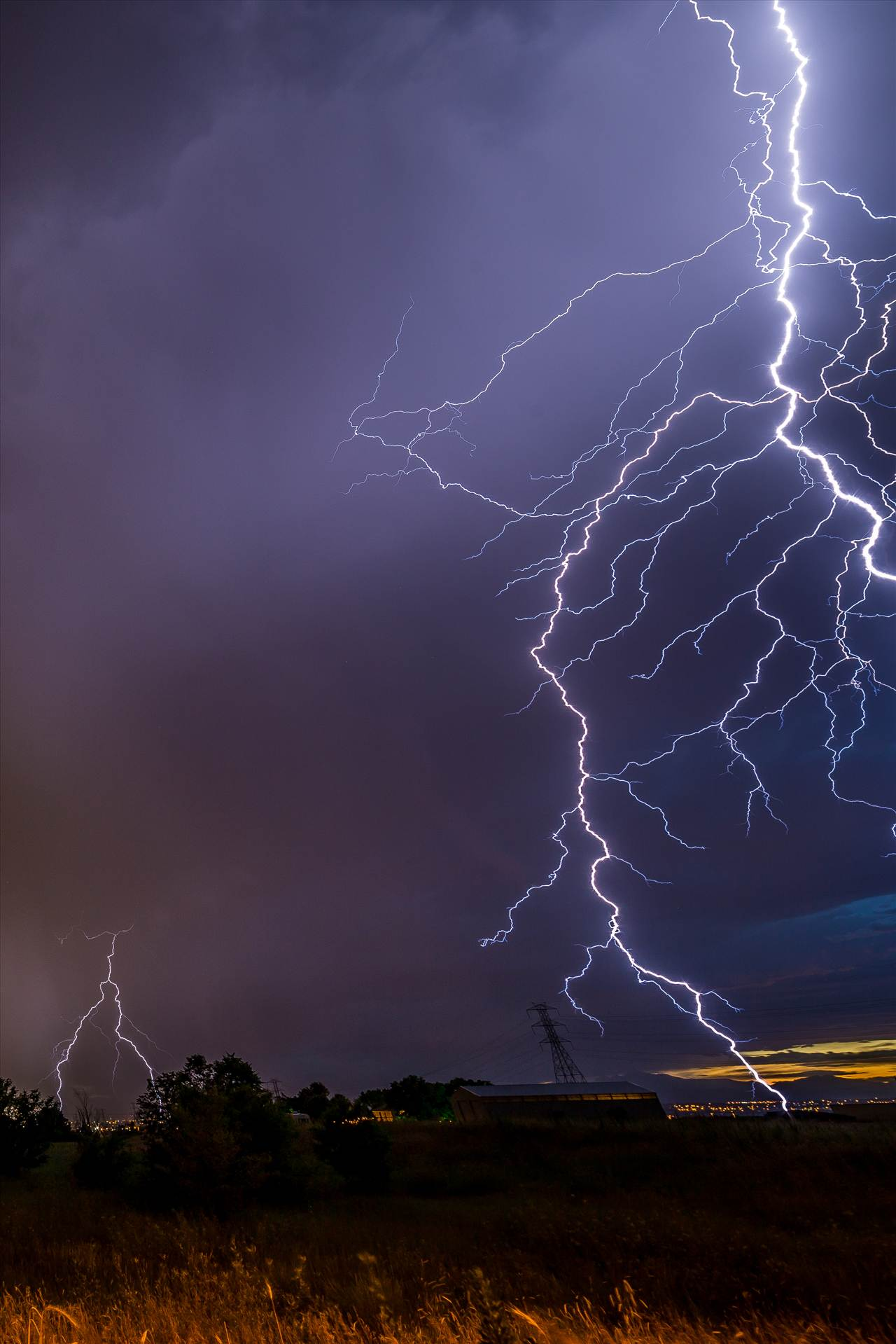 Lightning Flashes 9 - A series of shots from the end of the street, during a powerful lightning storm near Reunion, Colorado. This one was so close it did't fit entirely in the frame. by D Scott Smith