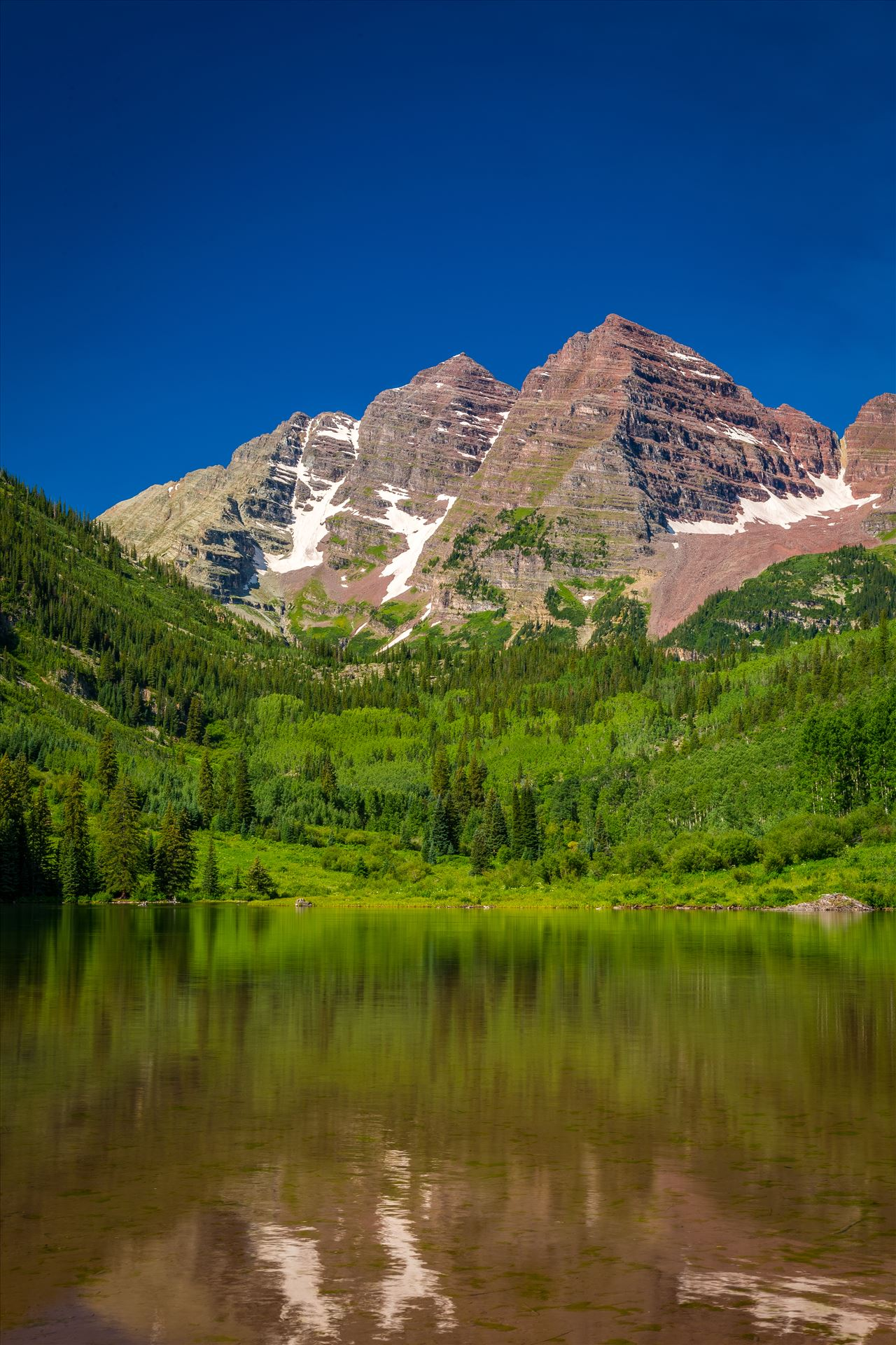 Maroon Bells in Summer No 07 - The remaining snow reflected in the water, at the Maroon Bells near Aspen, Colorado. by D Scott Smith