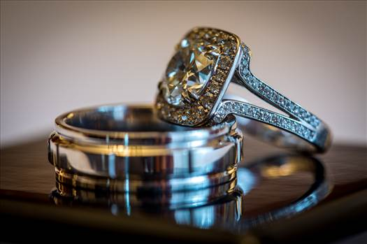 A close up of wedding rings just before a ceremony.
