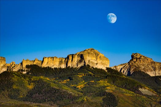 The moon rises over Chimney Peak outside of Ridgeway, Colorado.
