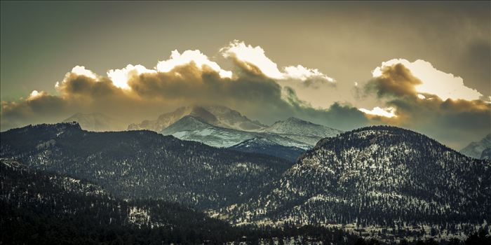The sun sets over peaks in the Rocky Mountain National Park, as seen from near the famous Stanley Hotel in Estes Park.