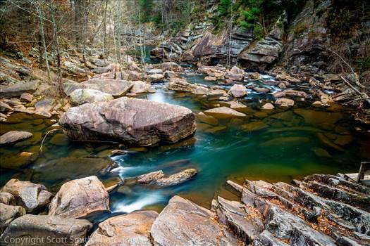 The beautiful emerald-green water at the bottom of Tallulah Gorge, Georgia.