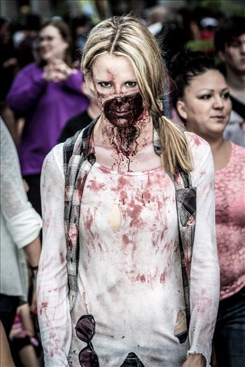 An attractive zombie walks the streets of Denver. Well, attractive to other zombies!