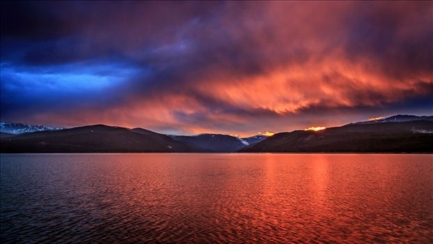 Sunset on the calm protected waters of Turqouise Lake, Leadville Colorado.