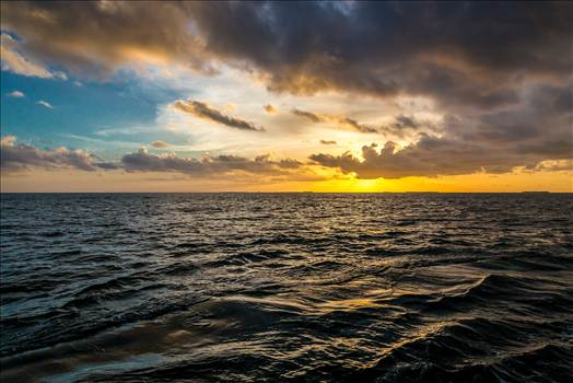 The sun sets outside of Key West, as seen from a catamaran cruise.