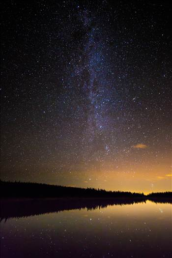 The Milky Way over Brainard Lake, on August 13th, during the Perseid meteor shower. No meteorites show in the image, but the reflection of the stars on the water is striking. The Andromeda galaxy makes an appearance, in the middle of the right half of the