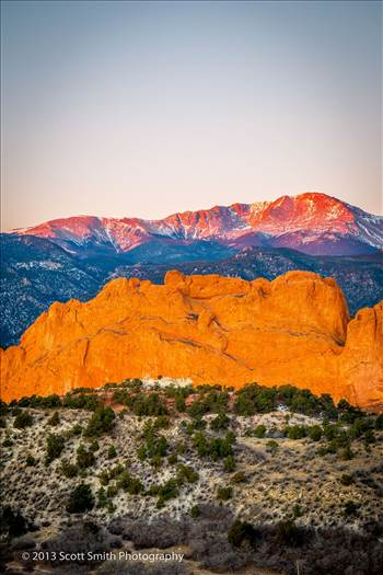 Pike's Peak, behind the Garden of the Gods, lit by the rising sun.