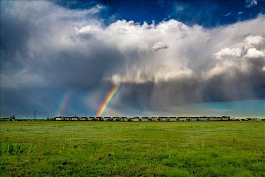 A double rainbow breaks through some clouds east of Denver.