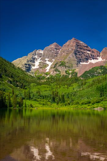 The remaining snow reflected in the water, at the Maroon Bells near Aspen, Colorado.