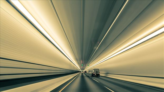 Lines nearly converge to infinity, in this long exposure handheld shot in Eisenhower Tunnel. Opened in 1973, the Eisenhower Tunnel in the Rocky Mountains of Colorado on interstate 70 is highest vehicle tunnel in the world at 11,155 feet.