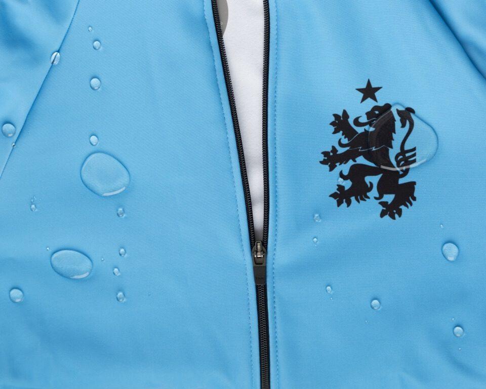 Orkaan Water proof cycling jersey de muur - stolen goat - blue water splash