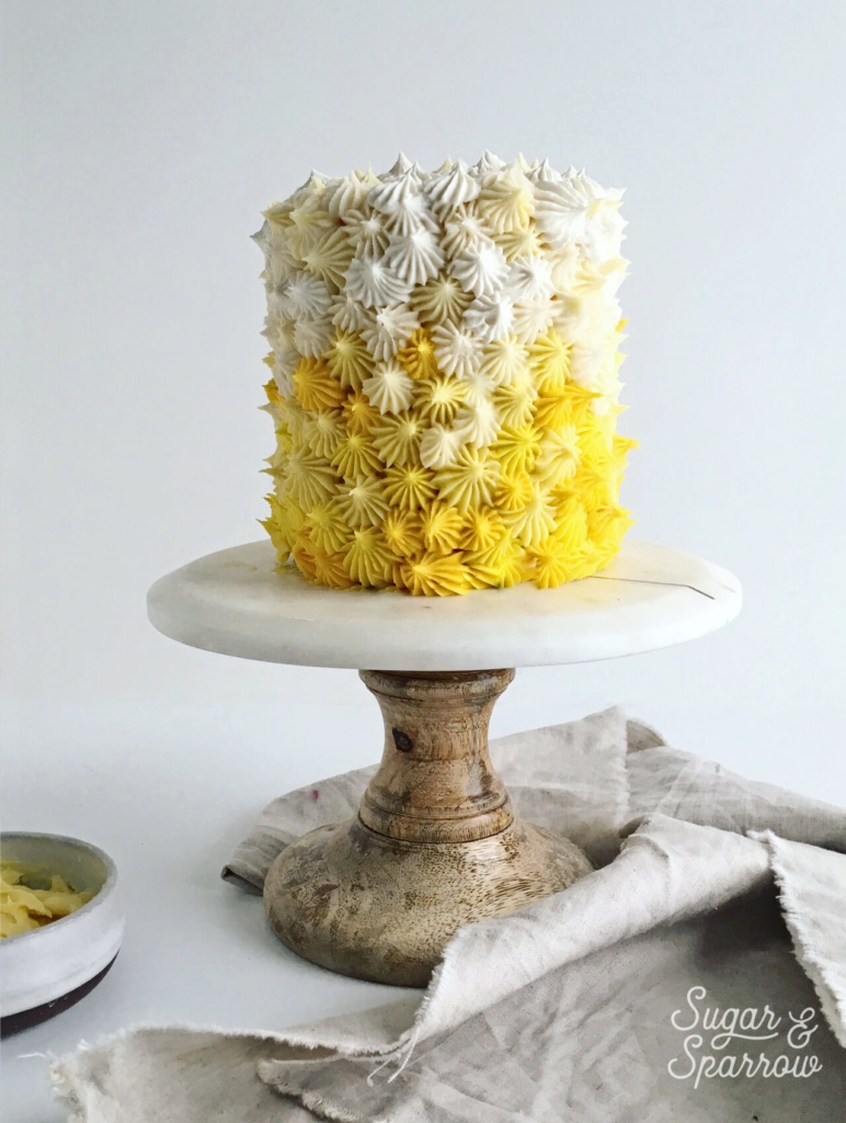 mango buttercream cake by sugar and sparrow