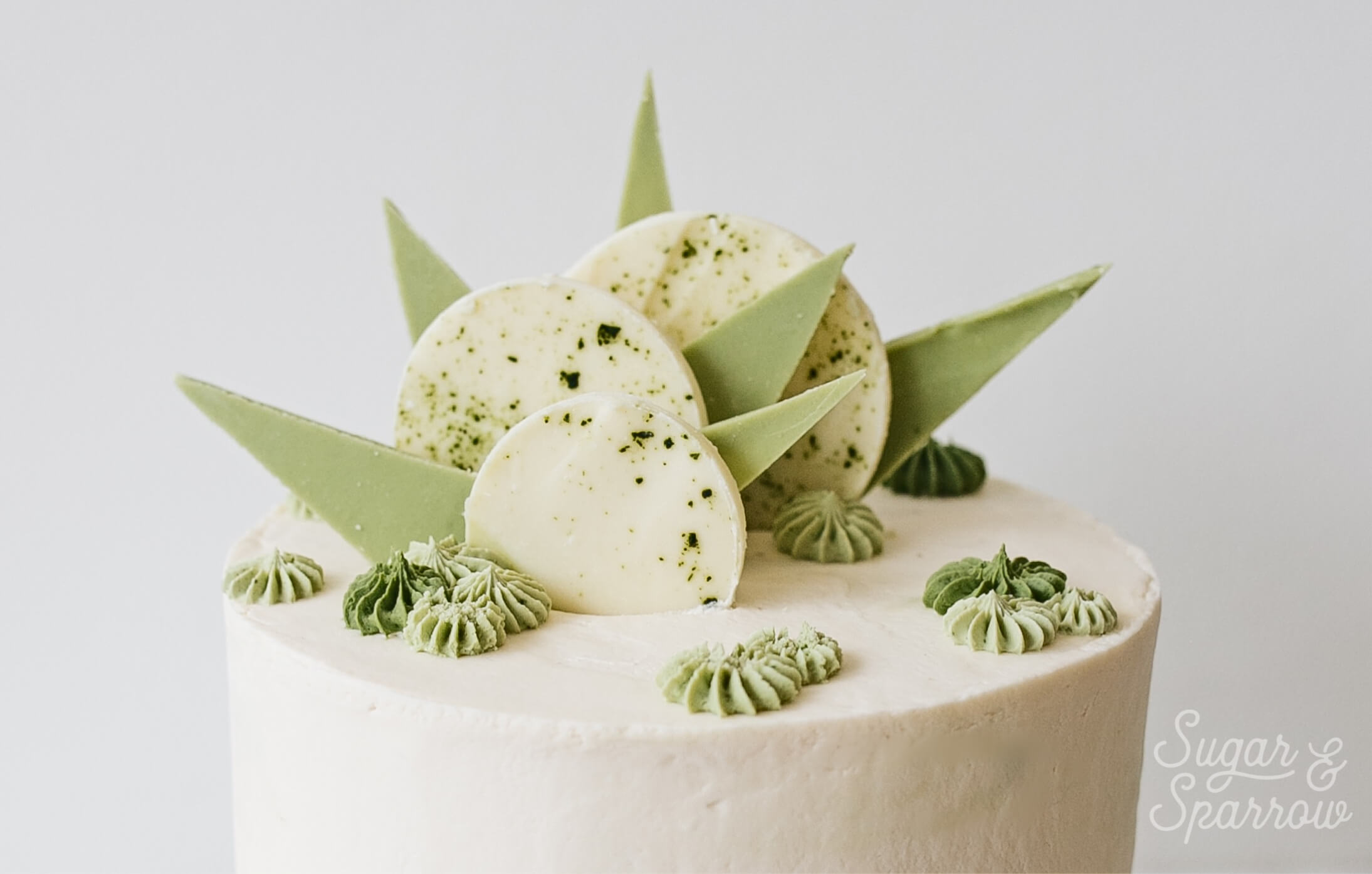 white chocolate matcha cake by sugar and sparrow
