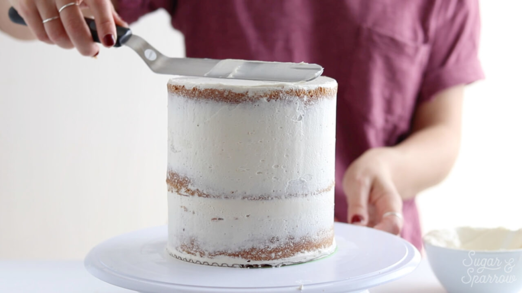how to crumb coat a cake by sugar and sparrow