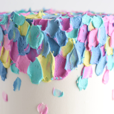 colorful buttercream cake by sugar and sparrow