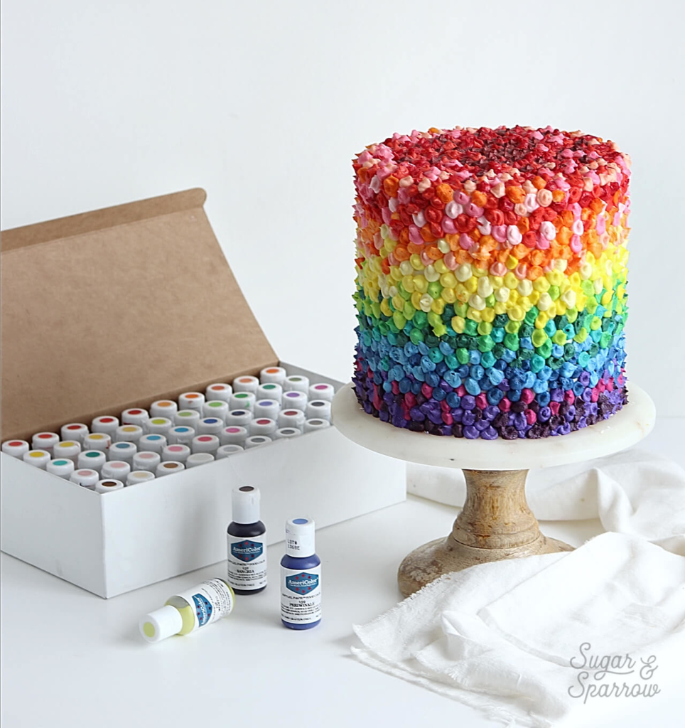 rainbow buttercream cake by sugar and sparrow