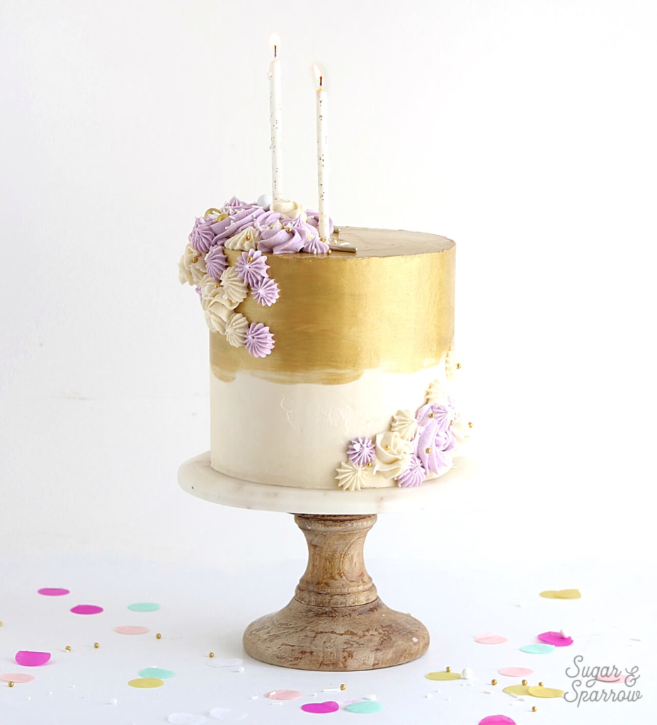 metallic gold buttercream cake by sugar and sparrow