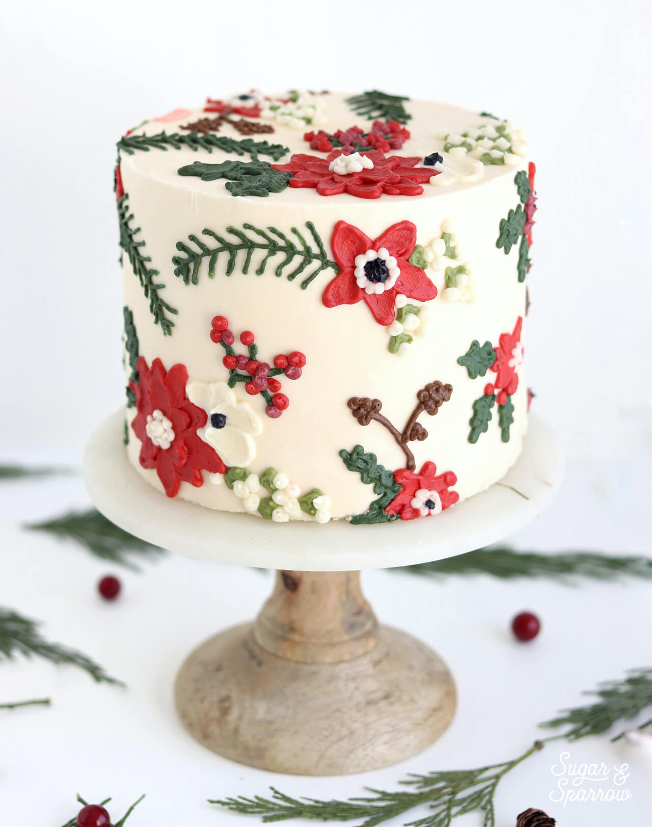 holiday floral pattern cake by sugar and sparrow