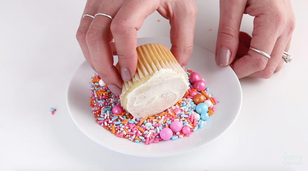 dipping cupcakes in sprinkles