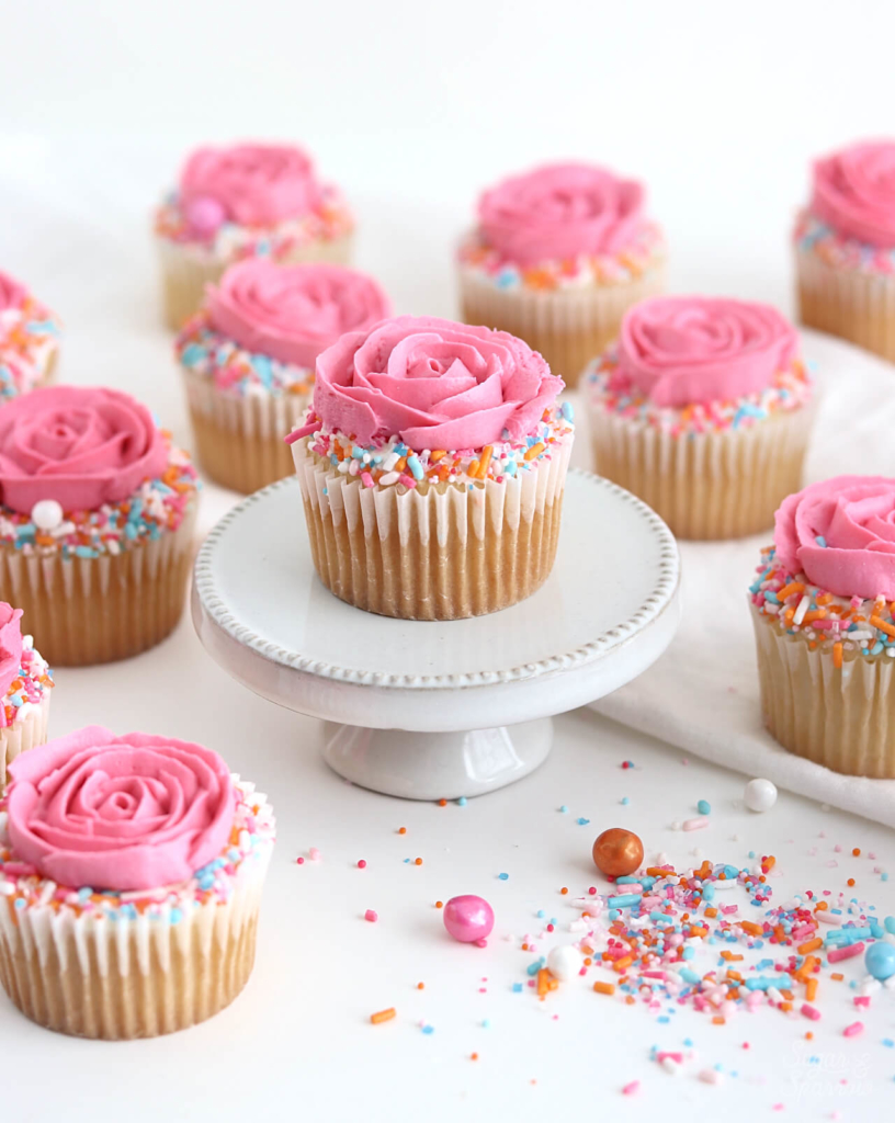 rose cupcakes with sprinkles by sugar and sparrow