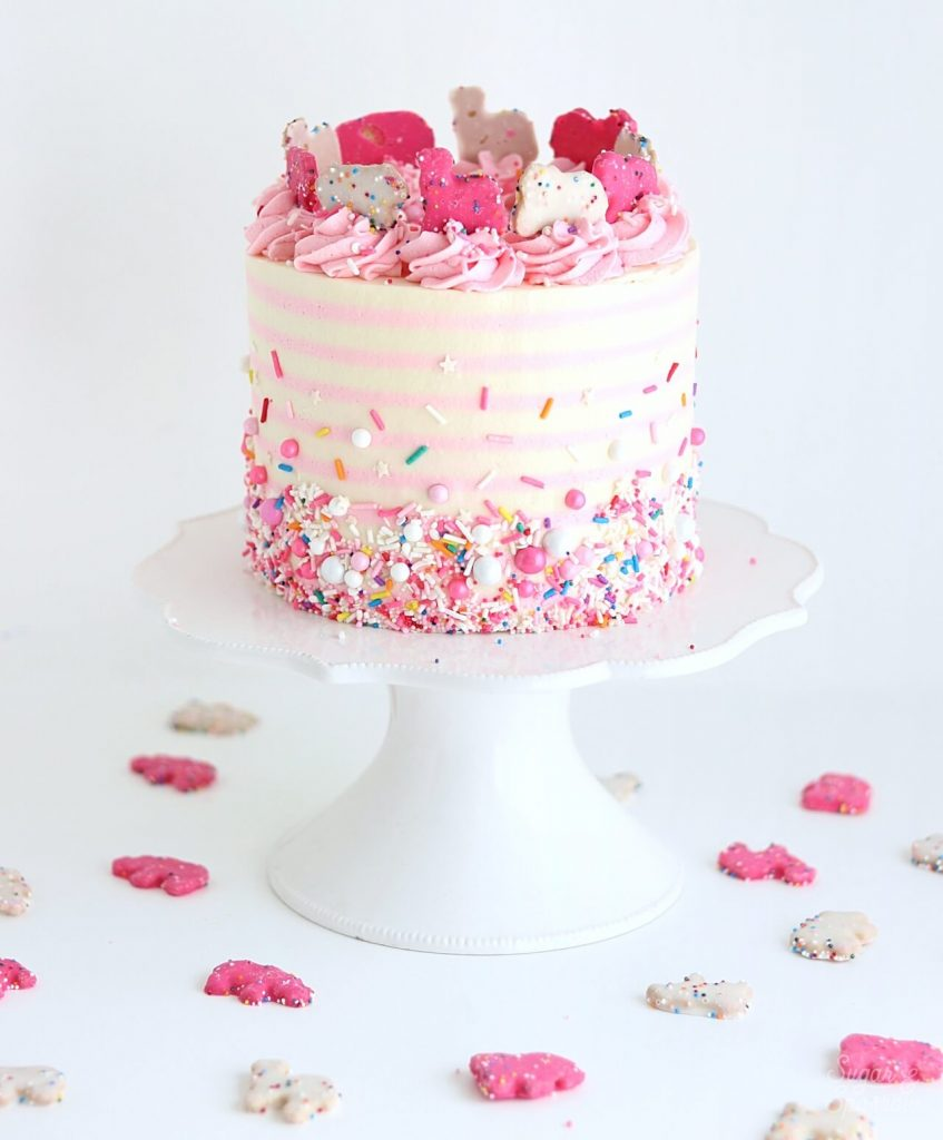 pink and white striped cak