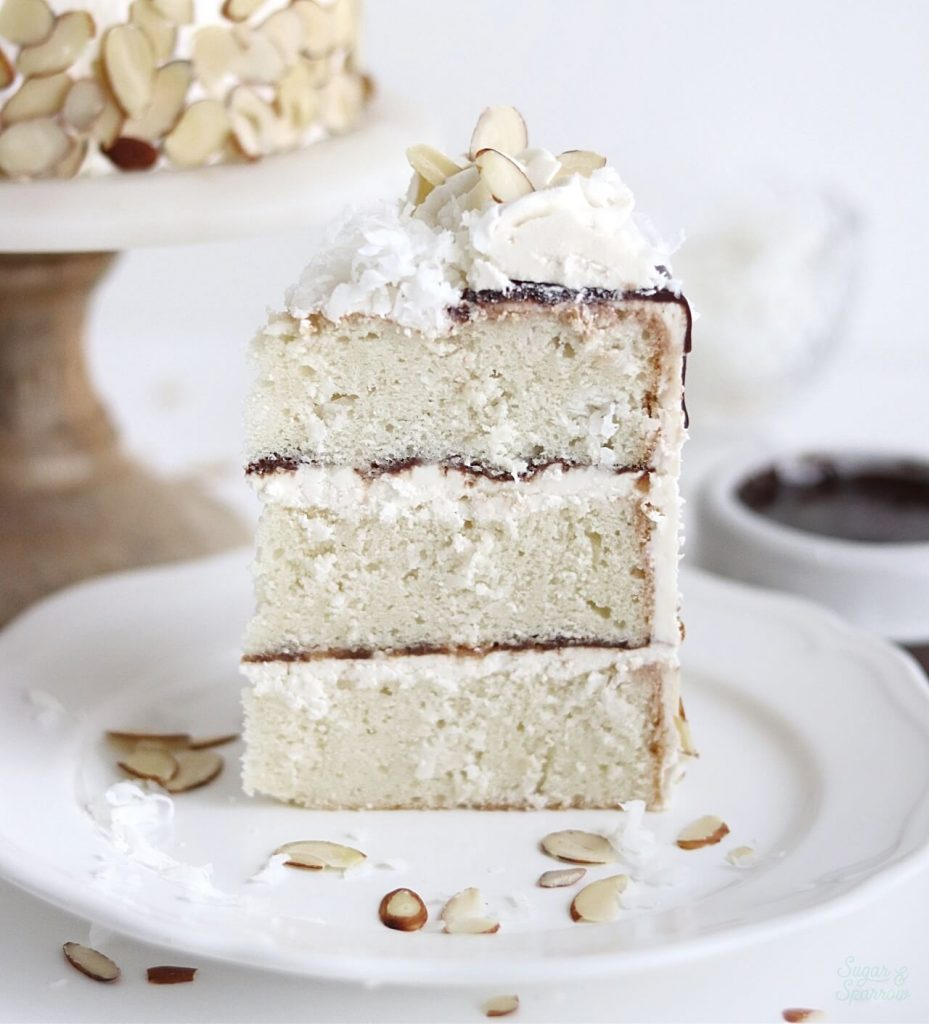 coconut cake with coconut buttercream and chocolate ganache